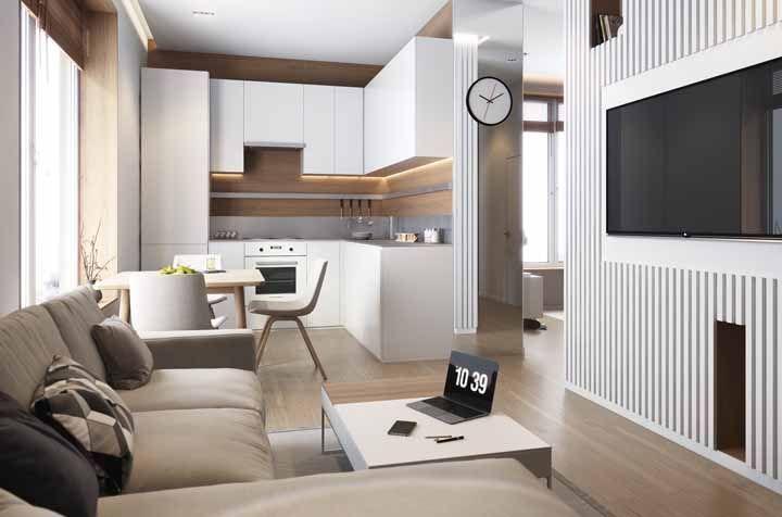 Uma ideia de ambiente conjugado de cozinha e sala de estar em tons neutros