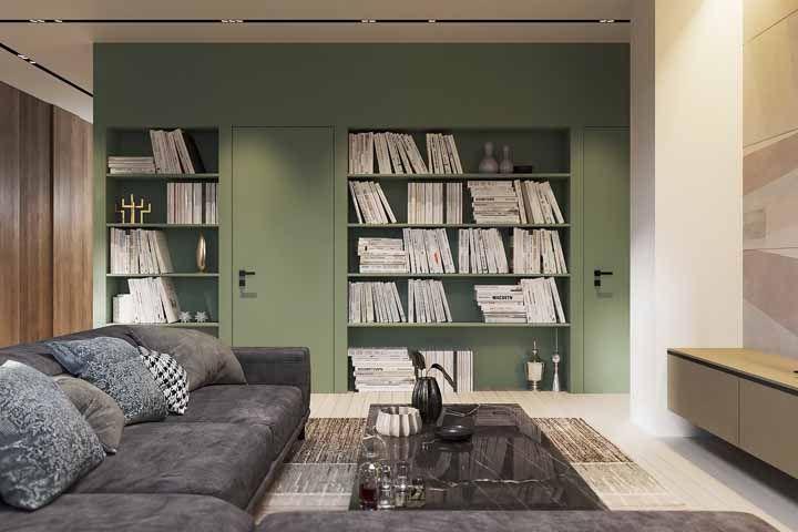 E não precisa ser um tom vibrante para chamar a atenção no cômodo, este verde militar também ganha destaque no ambiente cinza