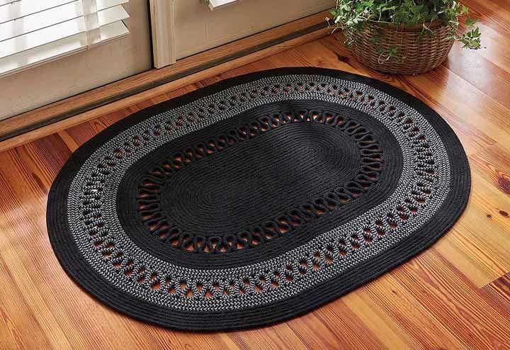 Preto e cinza numa peça oval super estruturada e sofisticada para a entrada de casa