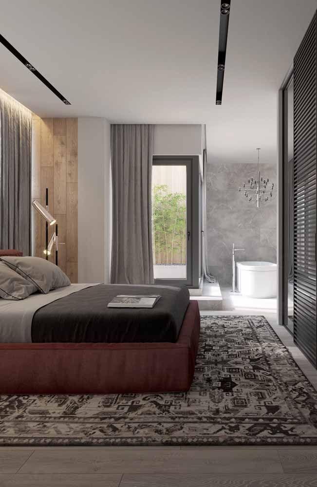 Nesse quarto, o vermelho fechado aparece de modo discreto na base da cama