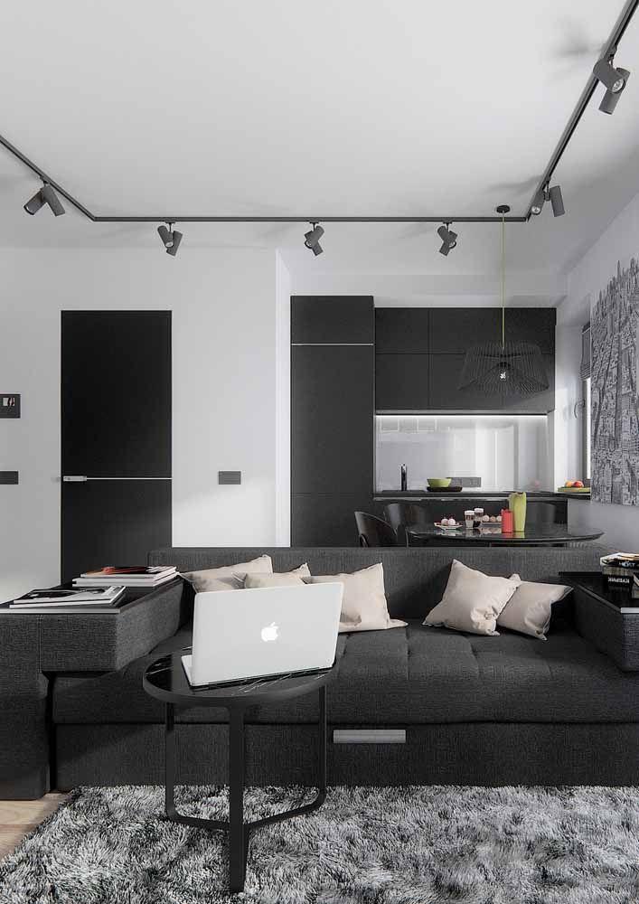 Preto e branco por todos os lados nessa casa de ambientes integrados