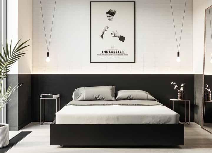 A cabeceira dessa cama nada mais é do que meia parede pintada de preto
