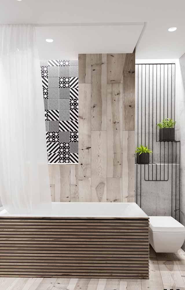 Nesse banheiro, os vasinhos pretos se harmonizaram muito bem com o restante da decor