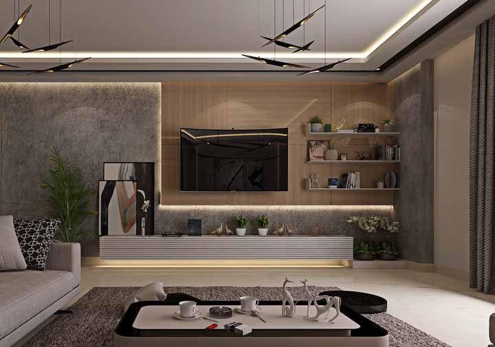 Iluminação com fita de LED no forro e no rack deixa a sala grande mais confortável