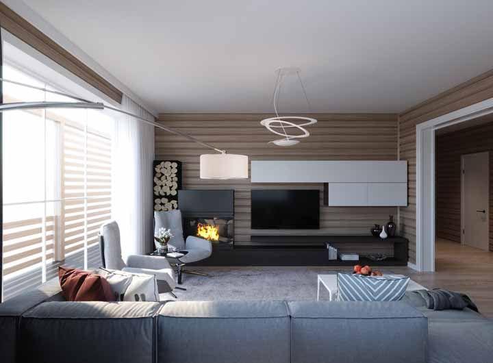 Sofá e cadeiras confortáveis anulam a sensação de frieza e impessoalidade que as salas grandes podem transmitir