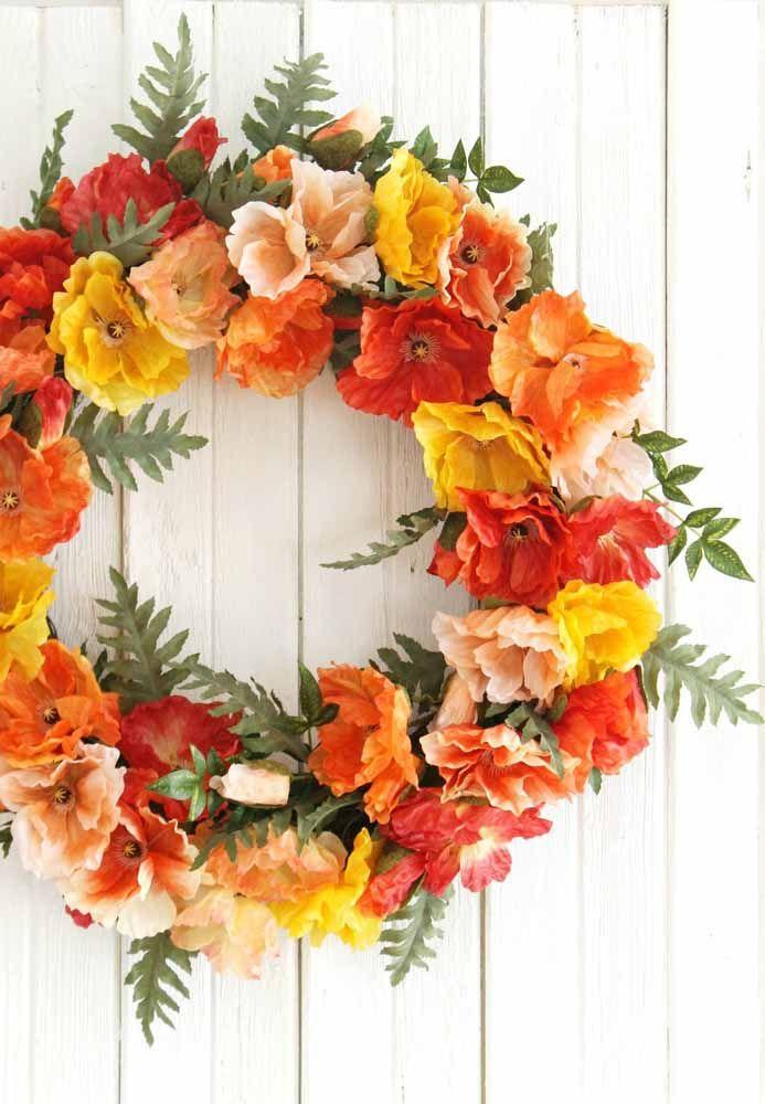 Guirlanda florida para a porta de entrada; quanto mais colorido mais bonito