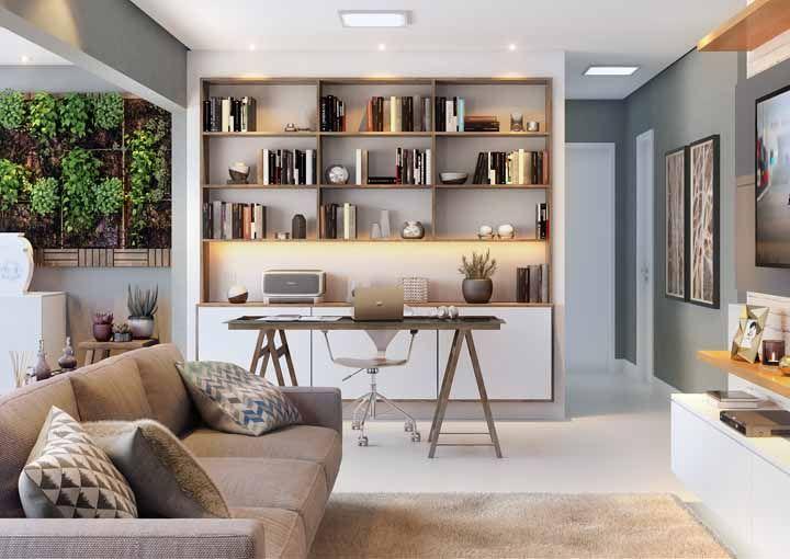 A sala, que também abriga um home office, usa nichos para atender os dois ambientes
