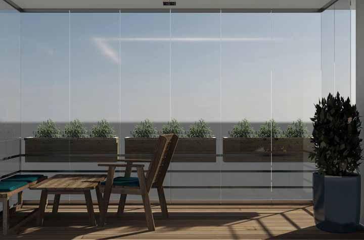 Para não atrapalhar ou sobrecarregar a área livre aposte em um jardim suspenso montada na parte externa da grade da varanda