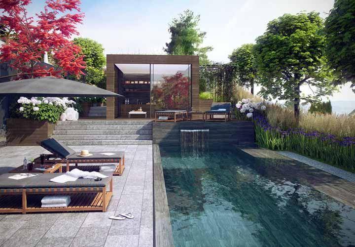 O modelo preto e discreto de ombrelone permite que o projeto de paisagismo seja o grande destaque dessa área externa