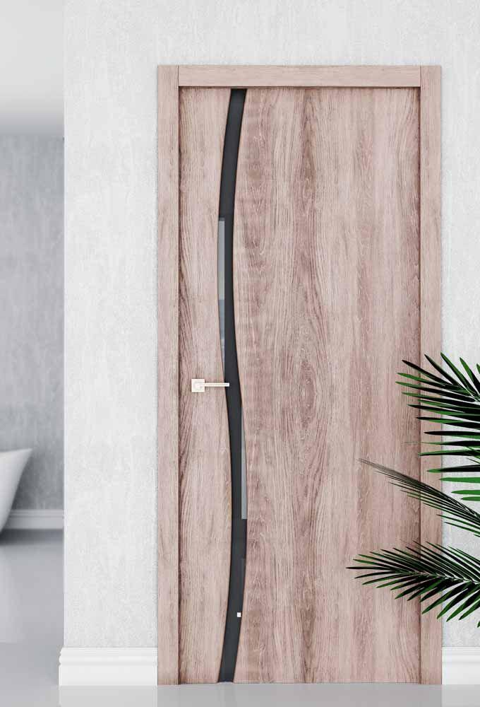Um mero detalhe e eis que a porta de madeira sai do status básico para o moderno e elegante