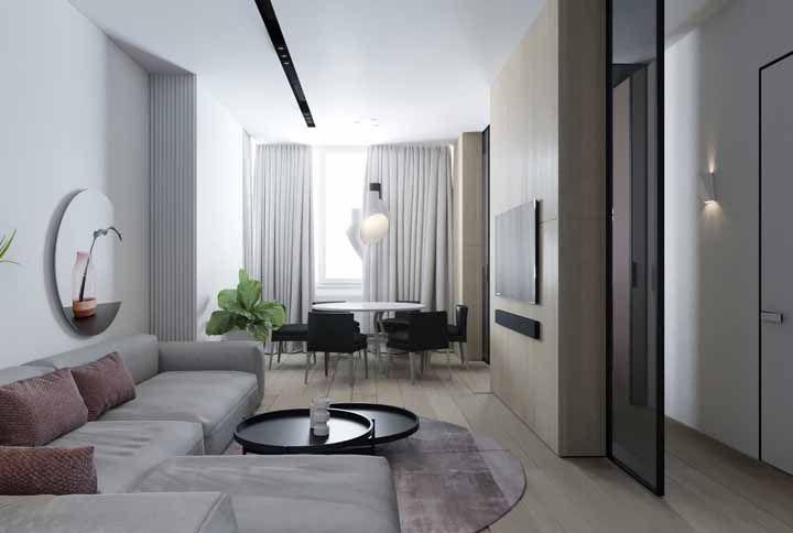 Sala de estar e de jantar compartilhando o mesmo piso