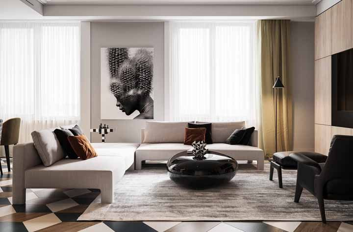 Combinação de cores e formas no piso para deixar a sala moderna e diferenciada