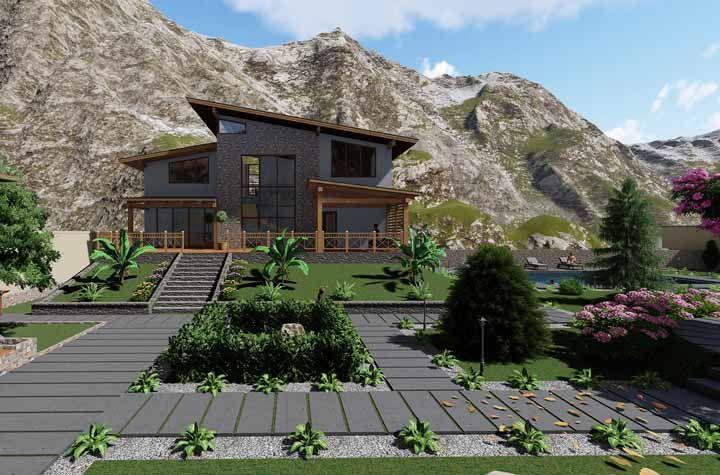 As montanhas ao fundo complementam naturalmente o paisagismo dessa casa