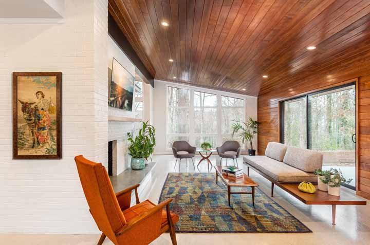 A junção perfeita entre o rústico e sofisticado da madeira com o moderno piso epóxi