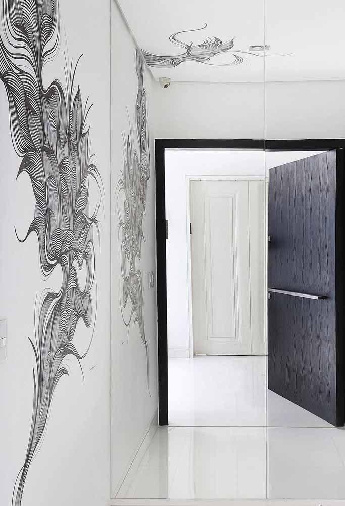 Não quer fugir da proposta neutra e moderna? Use um adesivo preto para criar contraste e movimento na parede
