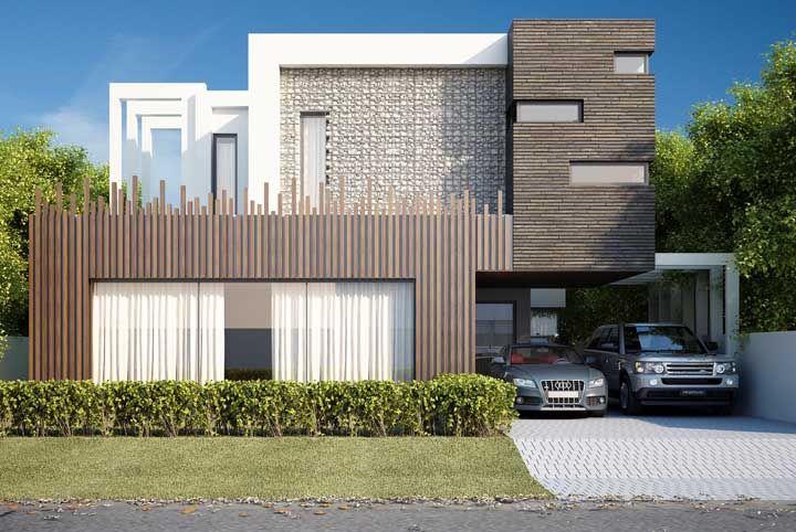 Gambiões de pedra, tijolinhos e madeira formam essa fachada moderna e original
