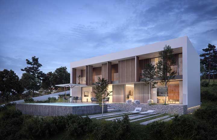 A casa de campo investiu em uma fachada de vidro para que a paisagem possa ser contemplada