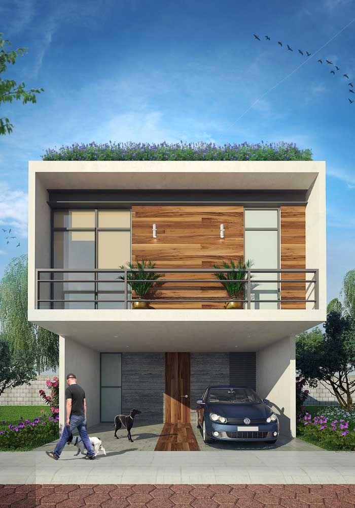 Fachada de casa com uma varanda confortável; para completar o projeto, um telhado verde
