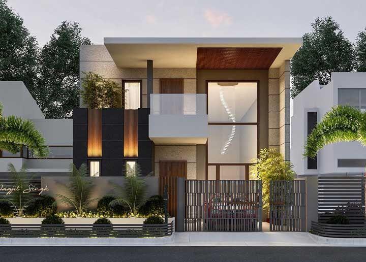 O jardim não precisa estar só no interior da casa; ele pode aparecer na calçada junto ao muro