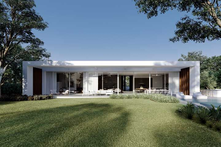 Fachada de vidro permite uma interação maior com a área externa da casa