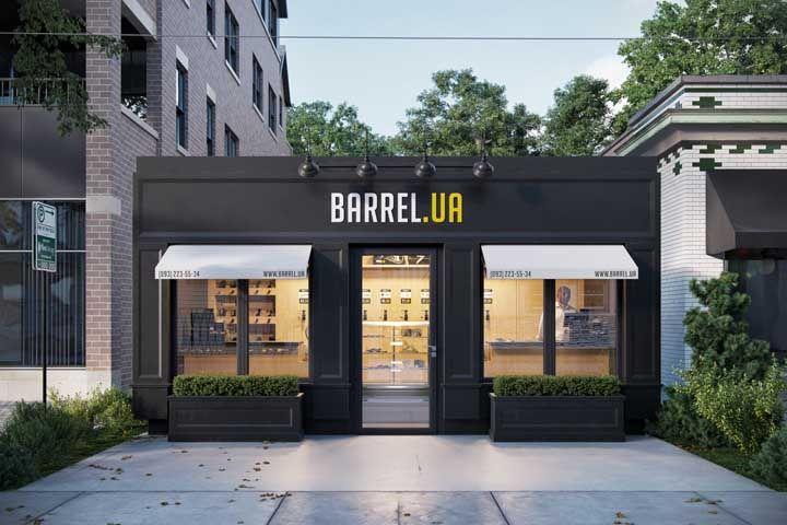 Uma fachada comercial preta, discreta e elegante que sabe como atrair a atenção dos clientes sem exageros