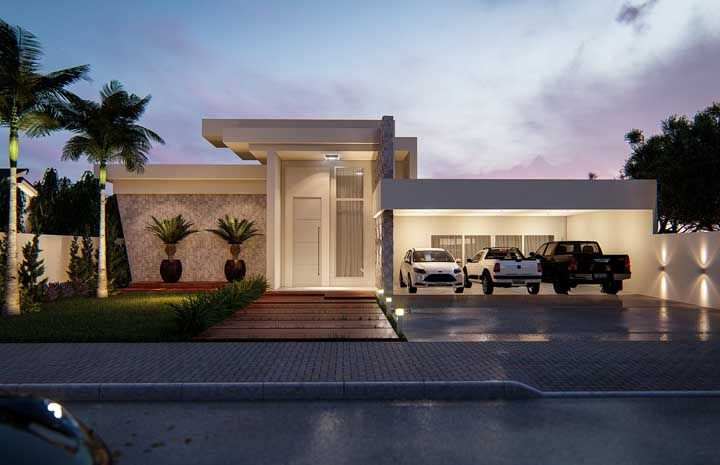 Um jardim de palmeiras para deixar a fachada da casa mais atraente e convidativa