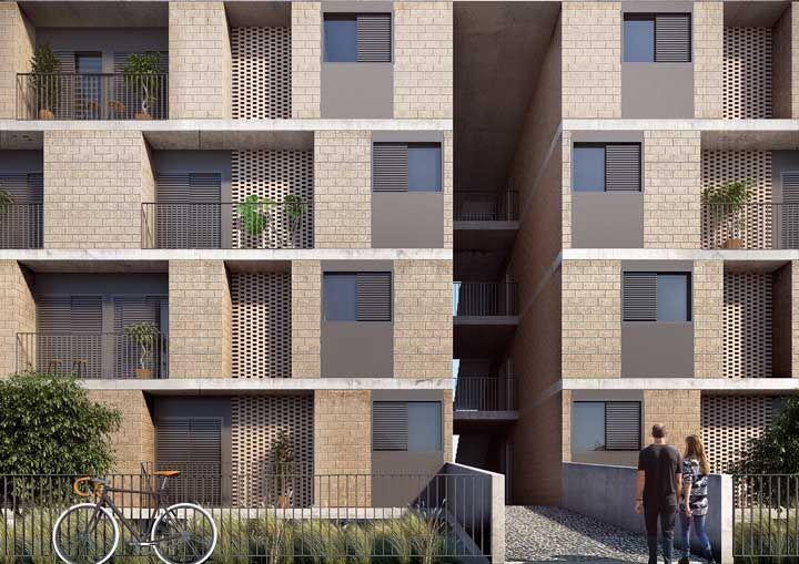 A fachada desse conjunto habitacional optou por cores terrosas e elementos naturais para criar uma ótima primeira impressão
