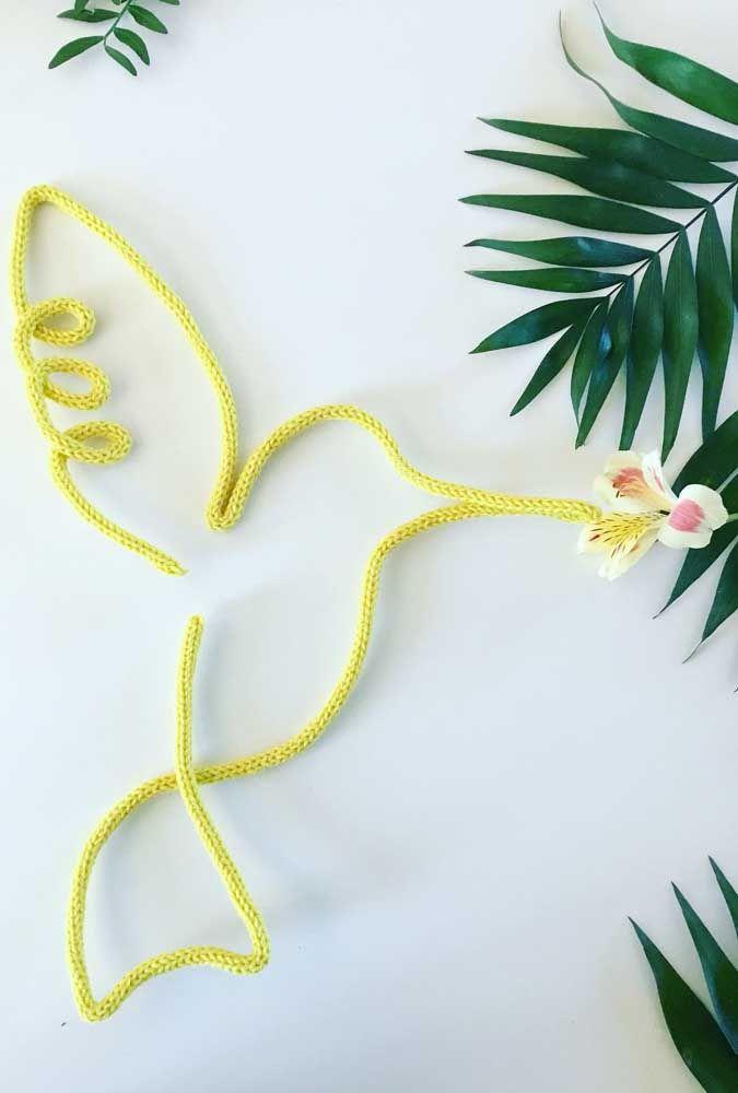 A delicadeza do beija flor representada na silhueta simples do tricotin