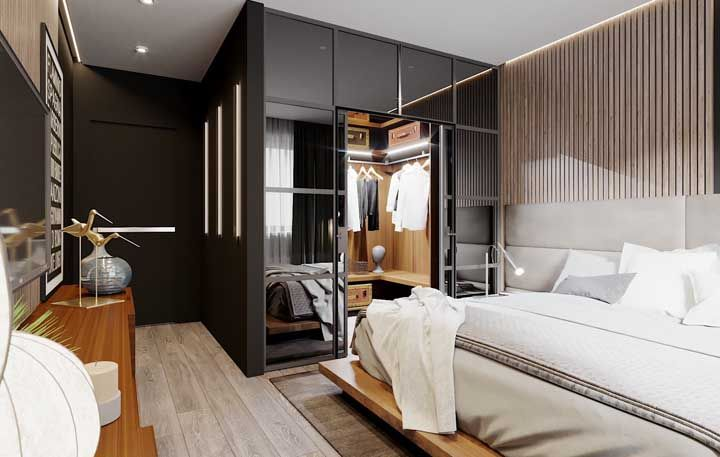 Um closet bem marcado e feito para aparecer dentro do quarto de casal