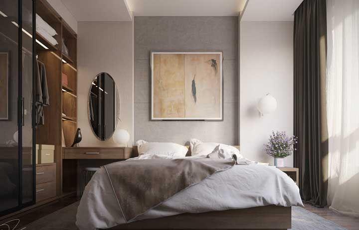 Penteadeira e closet planejados em conjunto nesse quarto de casal
