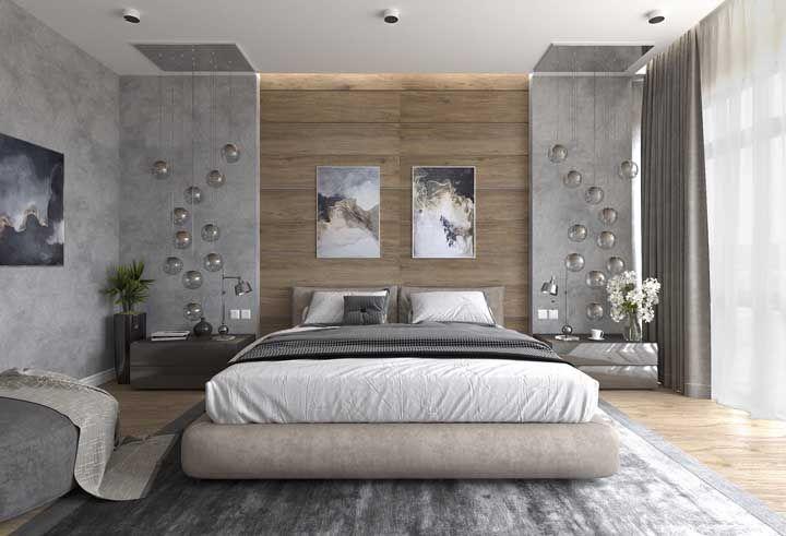 A graça desse quarto está nos pendentes redondos que descem pelas laterais da cama