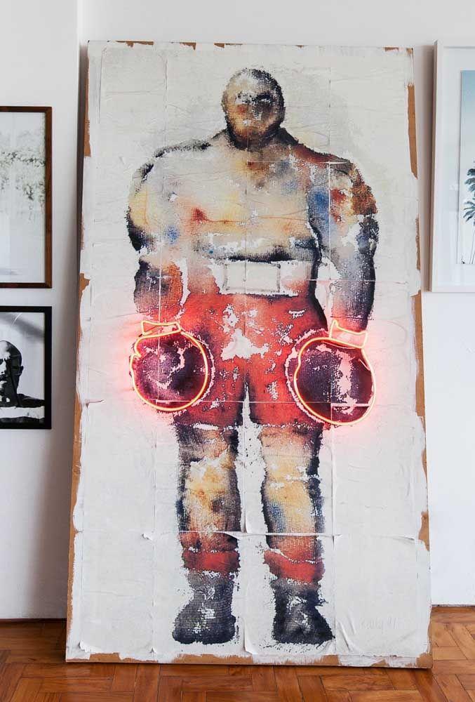 Da mesma forma você pode fazer com um quadro. Nesse caso, a luz neon serve para iluminar as luvas do boxeador