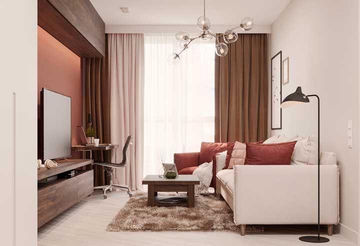 Na sala, a luminária de teto precisa ser cem por cento funcional e decorativa