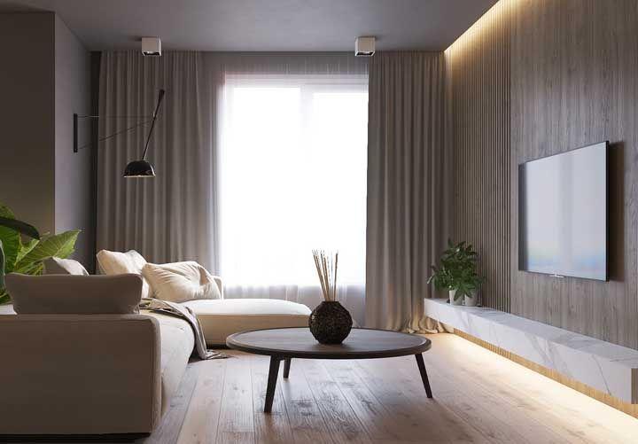 Crie uma iluminação especial para valorizar a sala – e o piso