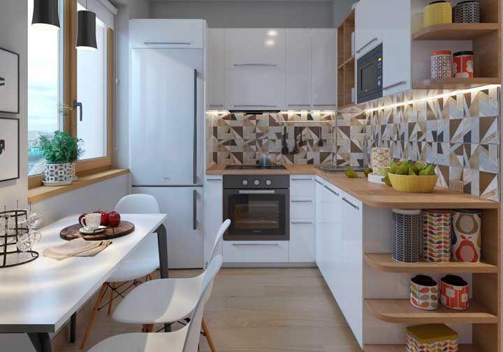 A cozinha pequena apostou no formato em L para trazer funcionalidade e estética ao projeto