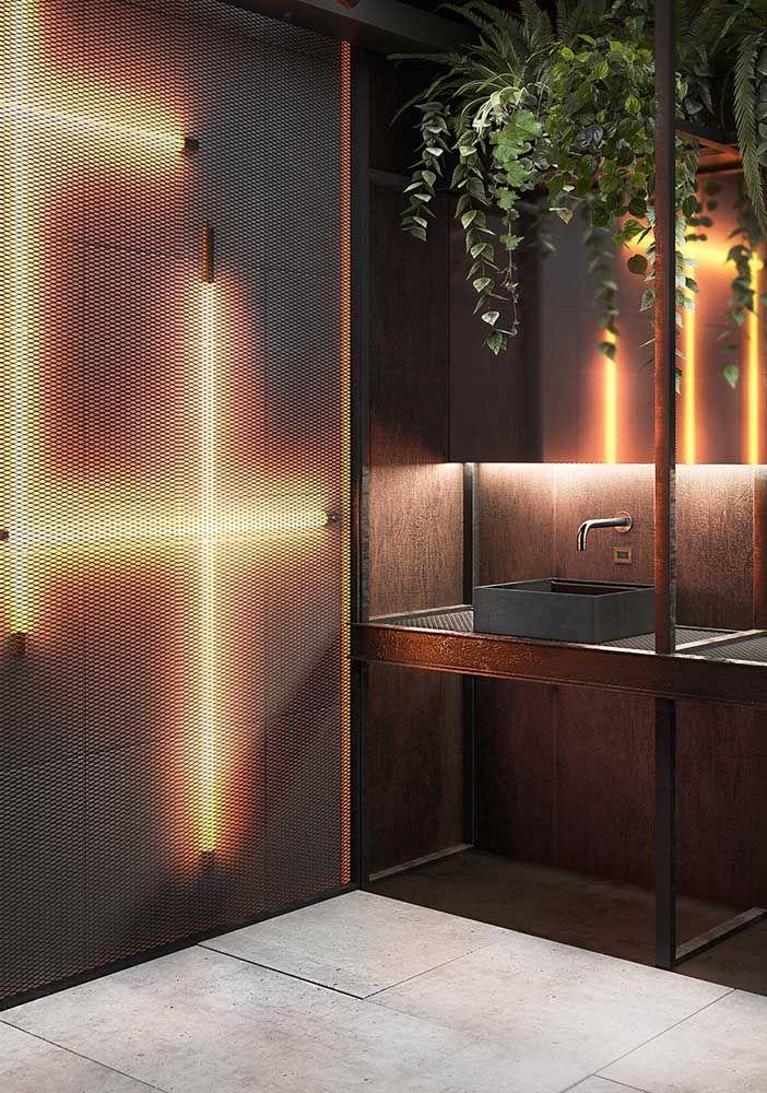 Banheiro moderno, industrial e iluminado com fitas de LED