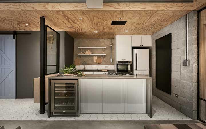 A decoração moderna permite a união entre diferentes texturas, como o concreto, o vidro e a madeira