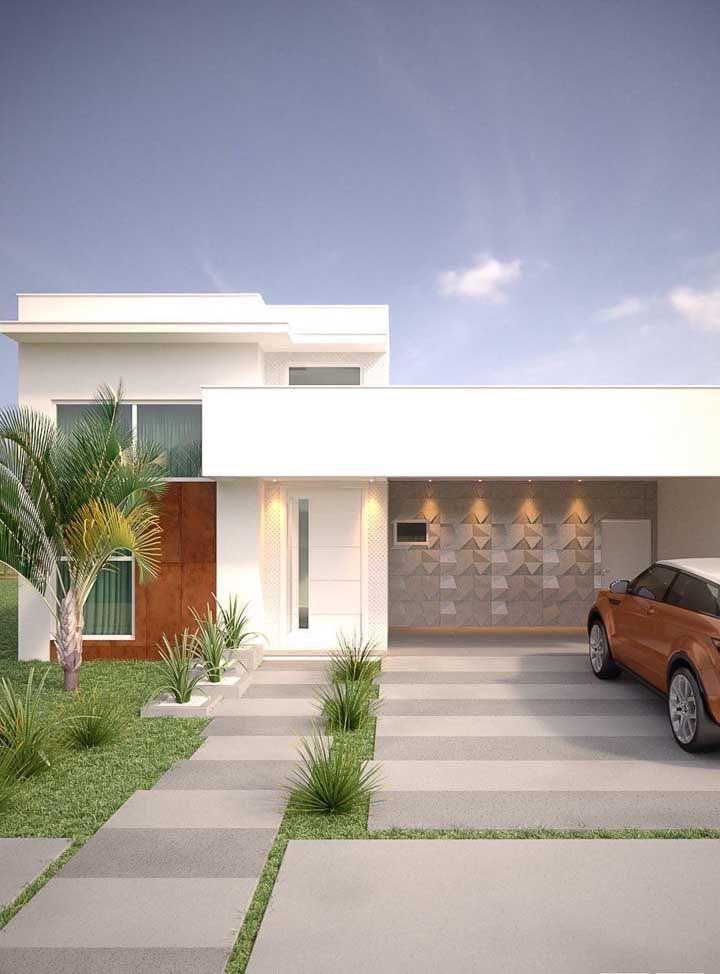 Parece só um detalhe, mas a parede 3D da garagem faz toda a diferença nesse projeto