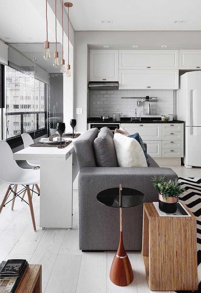 Móveis planejados e integrados foi aposta para esse pequeno apartamento
