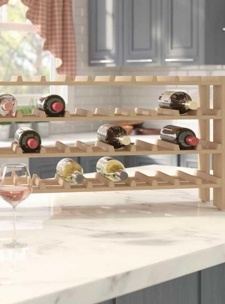 Outra opção interessante de adega de madeira são essas que podem ser apoiadas sobre a mesa ou a bancada, movimentando-a conforme a necessidade