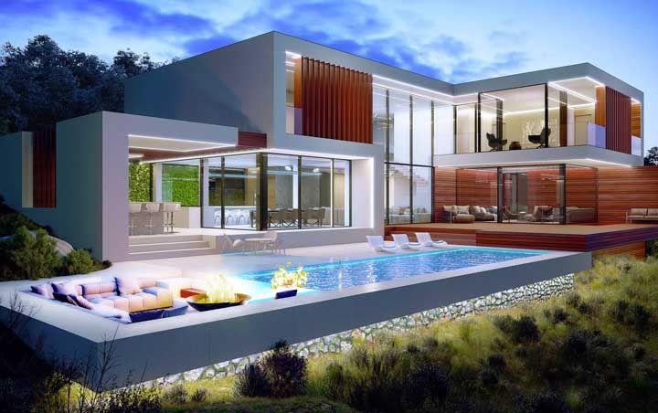 Madeira, vidro e alvenaria são os materiais escolhidos para essa casa com piscina