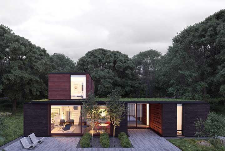 Já essa outra casa em L apostou no conceito de sustentabilidade para ficar completa