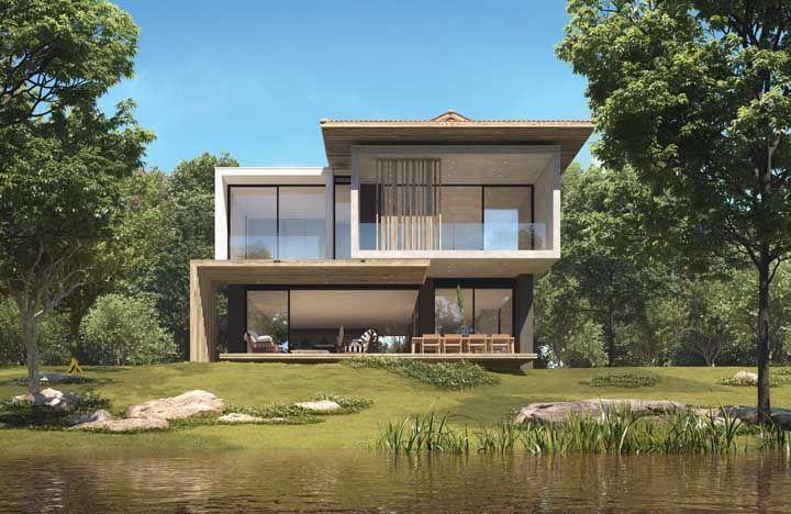 Próxima ao lago, essa casa de fazenda abandonou o conceito tradicional que cerca esse tipo de moradia e apostou em um visual moderno e arrojado