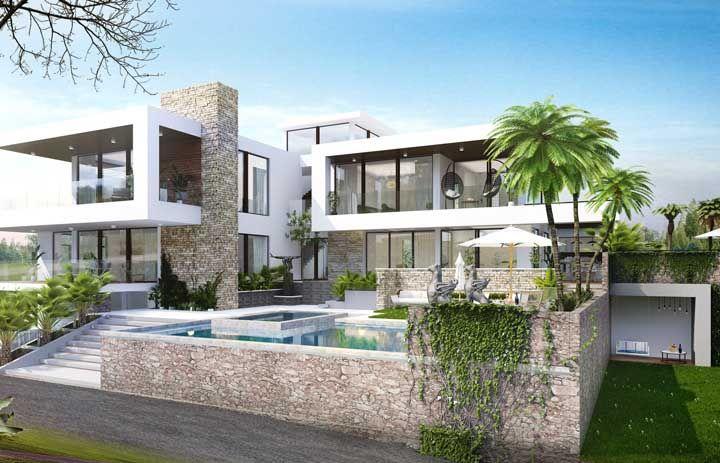 Já para essa casa grande, a opção foi por uma fachada de pedra