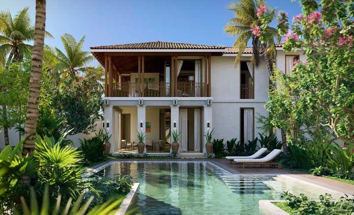 Uma casa na praia precisa ser arejada e bem iluminada, como essa da imagem