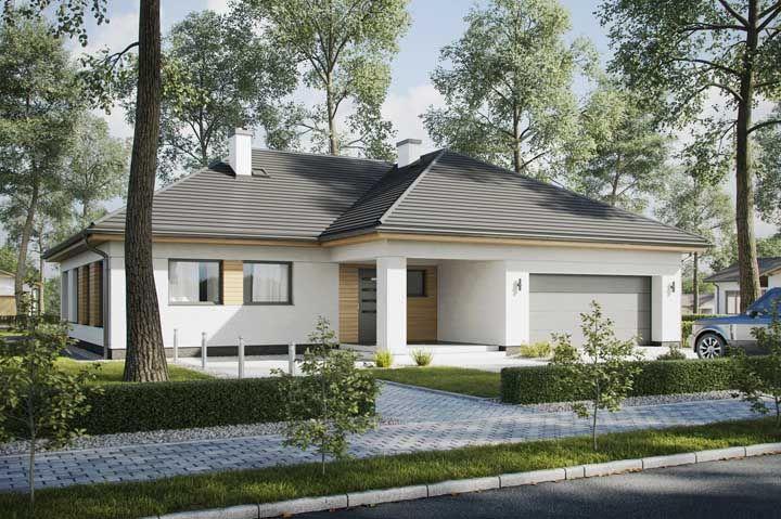 Uma casa simples combina com uma fachada bem pintada e um jardim cuidado com carinho
