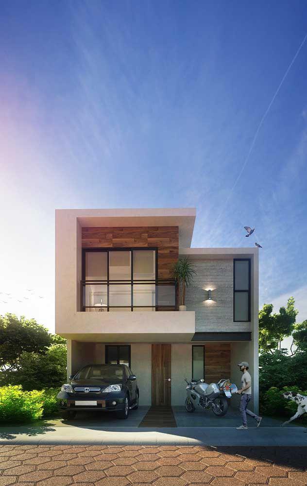 """Nesse sobrado, a platibanda se """"estende"""" pelas laterais da casa e forma uma moldura quase completa na fachada"""