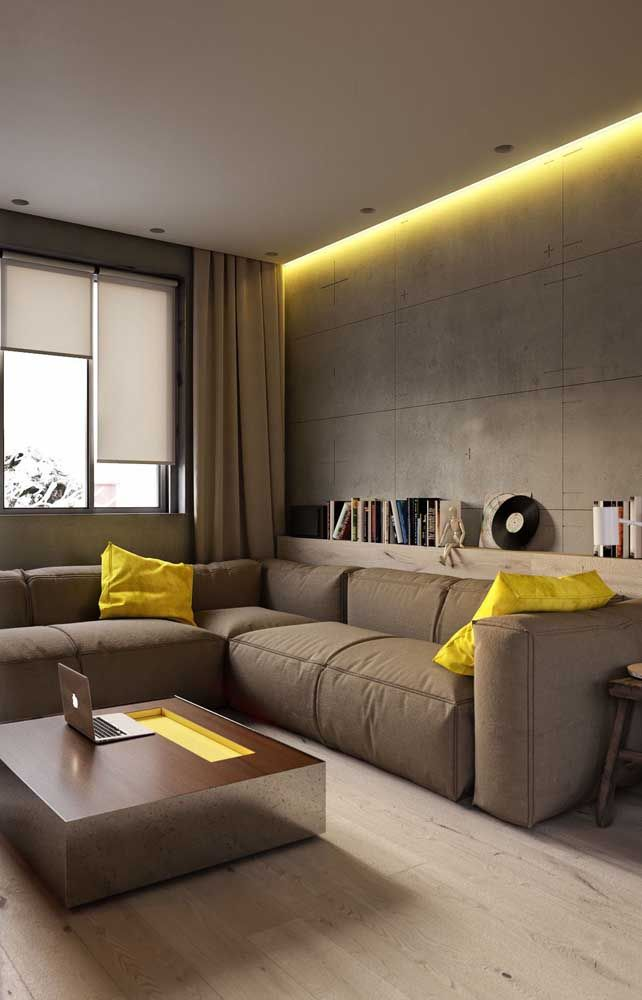 Encostado junto às paredes, o sofá em L libera espaço central na sala sem perder no quesito conforto