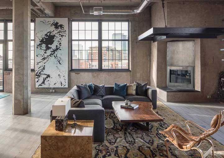 Um ótimo exemplo de como você pode usar o sofá em L para demarcar um ambiente