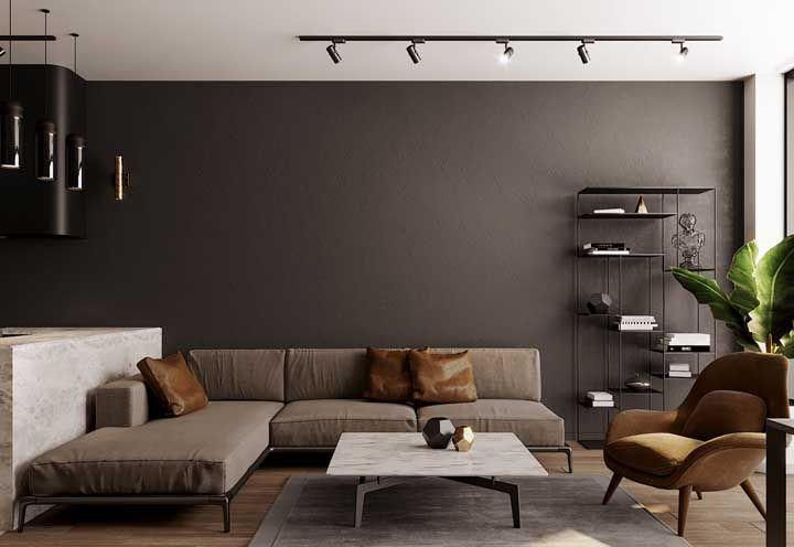 A base metálica desse sofá em L dá continuidade a proposta industrial da decoração